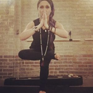 Megan Sax Intuitive candlight yoga flow in Denver Colorado